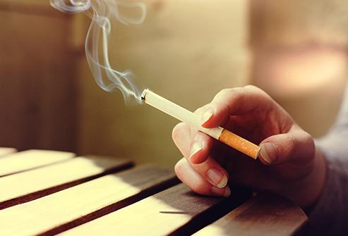 493ss_thinkstock_rf_hand_holding_lighted_cigarette
